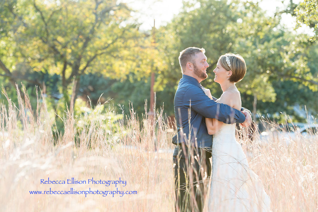 Bride and groom amongst the native grasses of Parker county at the outdoor wedding venue Hollow Hill Event Center