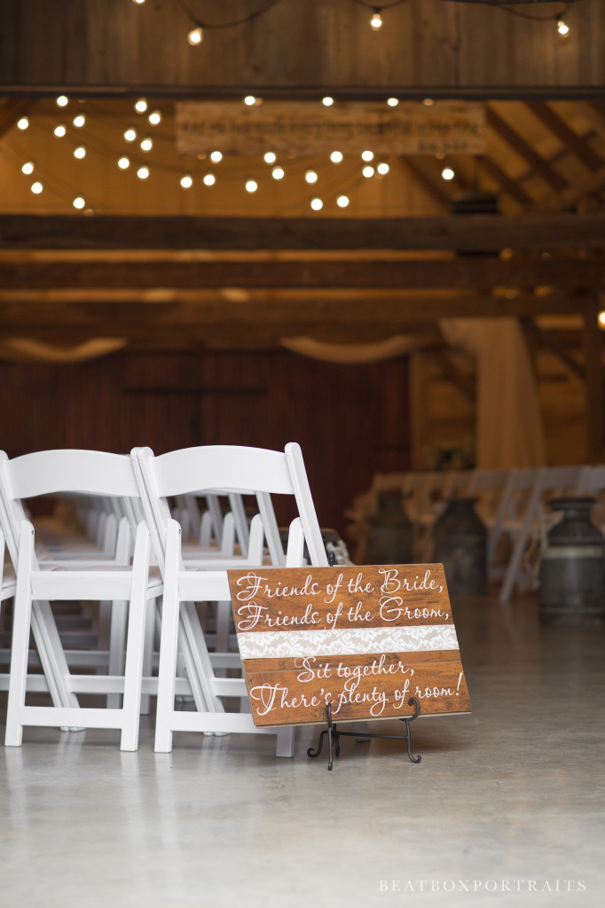 Rustic barn ceremony in indoor wedding venue