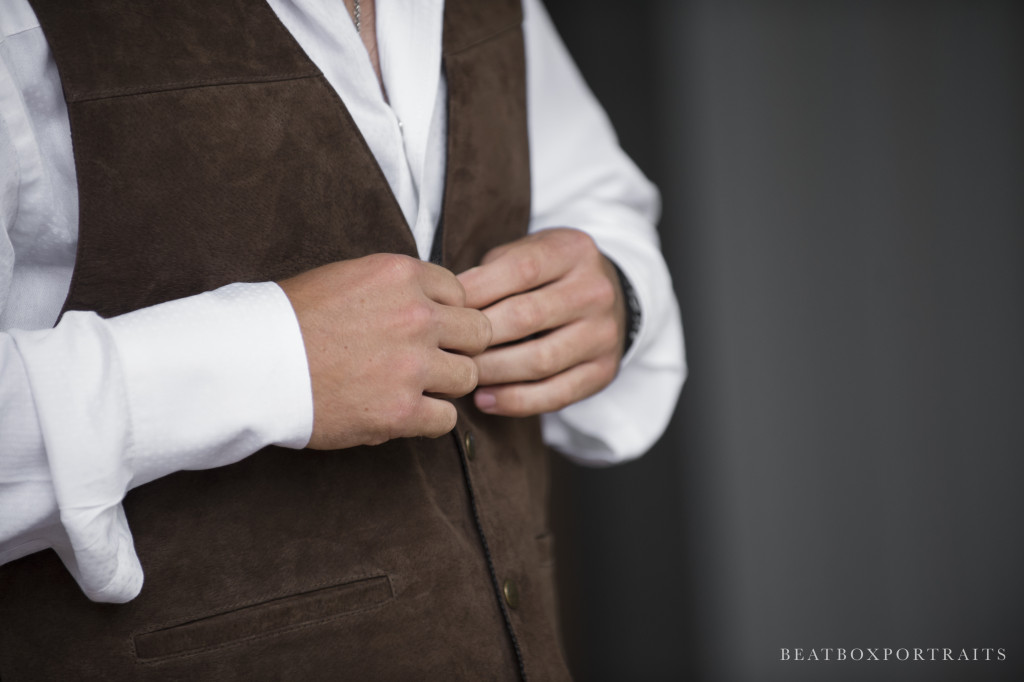 This groom's suede vest goes right along with Hollow Hill's romantic and rustic ambiance