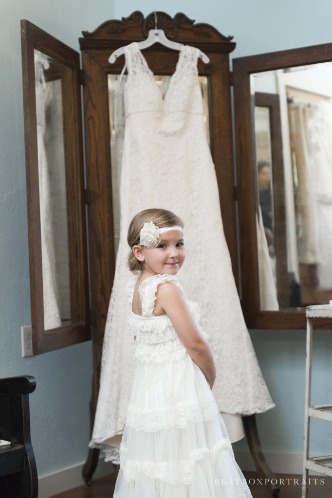 This sweet flower girl has finished getting ready in Hollow Hill's Hen House and is excited to walk down the aisle