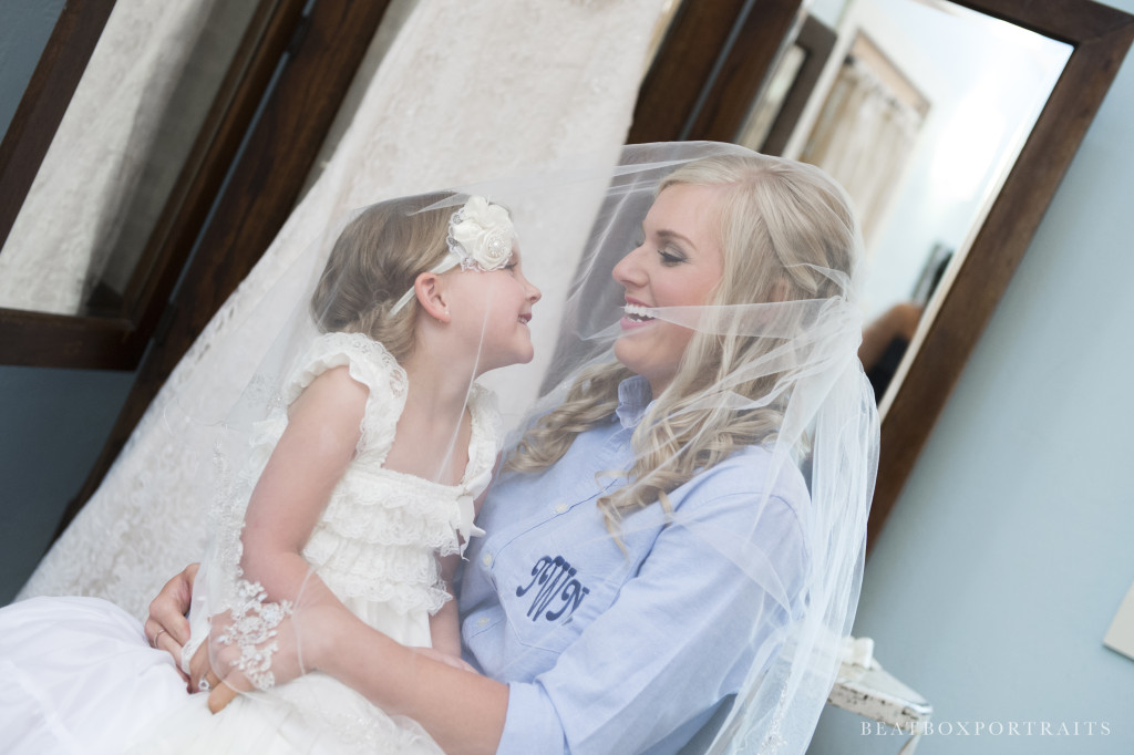 Bride and Flower Girl sharing a laugh