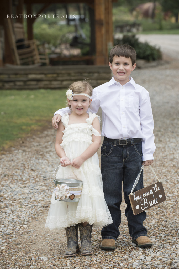 Flower girl and ring bearer are ready for a country wedding
