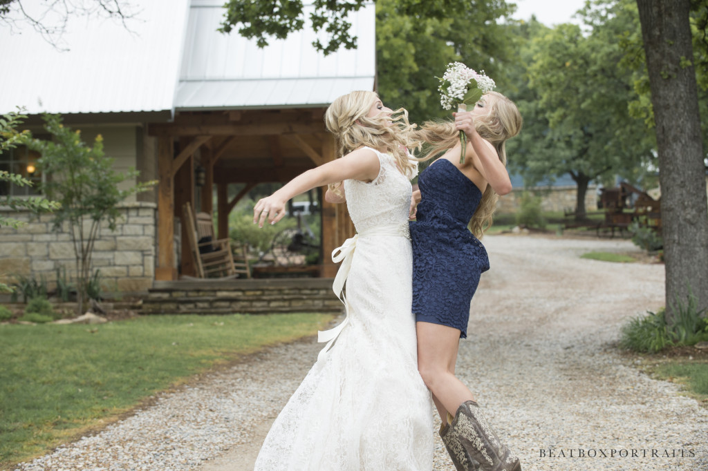 Bride and bridesmaid having a good time at Hollow Hill
