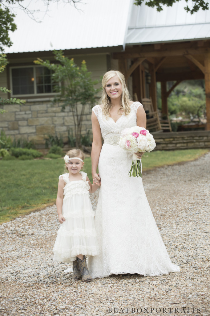 Bride and flower girl outside the Great Room at Hollow Hill