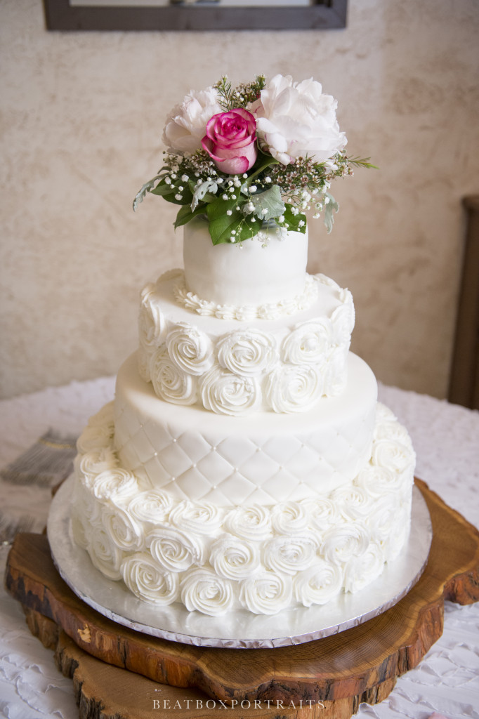 Beautiful wedding cake adorned with roses