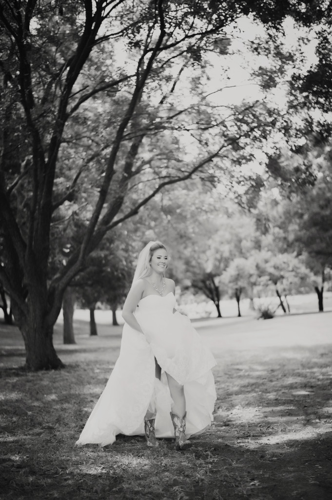 A Hollow Hill bride enjoys a walk under the trees at this outdoor wedding venue