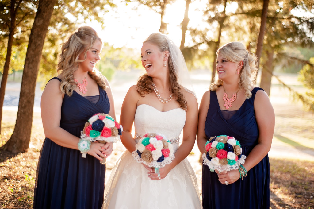 A bride and her bridesmaids under the shade of these Texas native trees just a stone's throw from Hollow Hill's water feature
