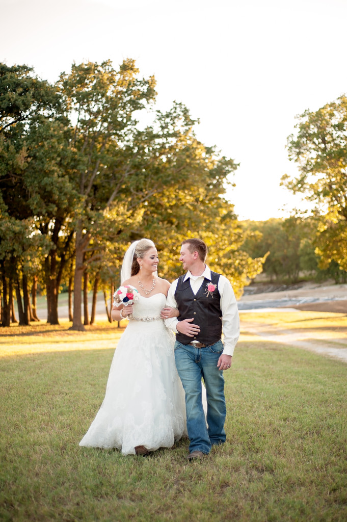 The happy bride and groom enjoying the peaceful countryside of Hollow Hill located just northwest of Fort Worth