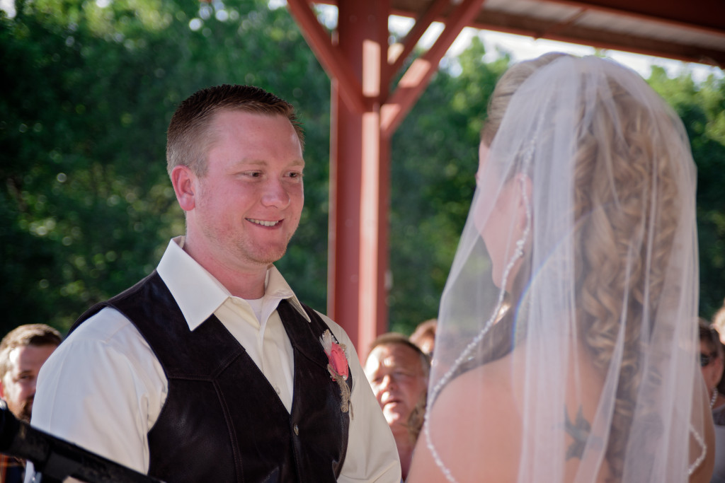 Saying 'I do' under this shaded outdoor ceremony site at Hollow Hill Event Center
