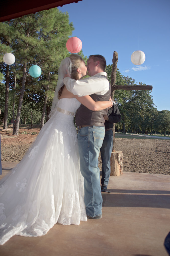 You may kiss the bride in the relaxing countryside of Hollow Hill in Weatherford, TX