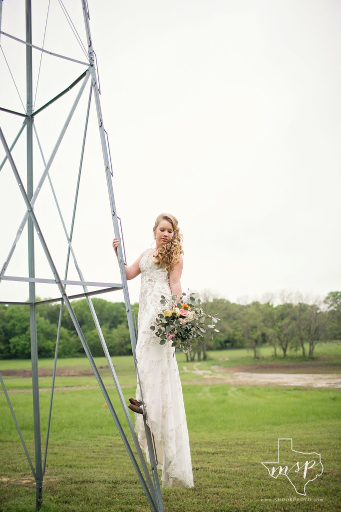 Bridals alongside a windmill surrounded by the countryside of Weatherford