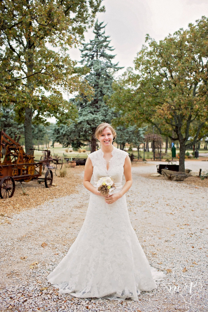 A bride happy with the peaceful country landscape of Hollow Hill Event Center located in the DFW metroplex