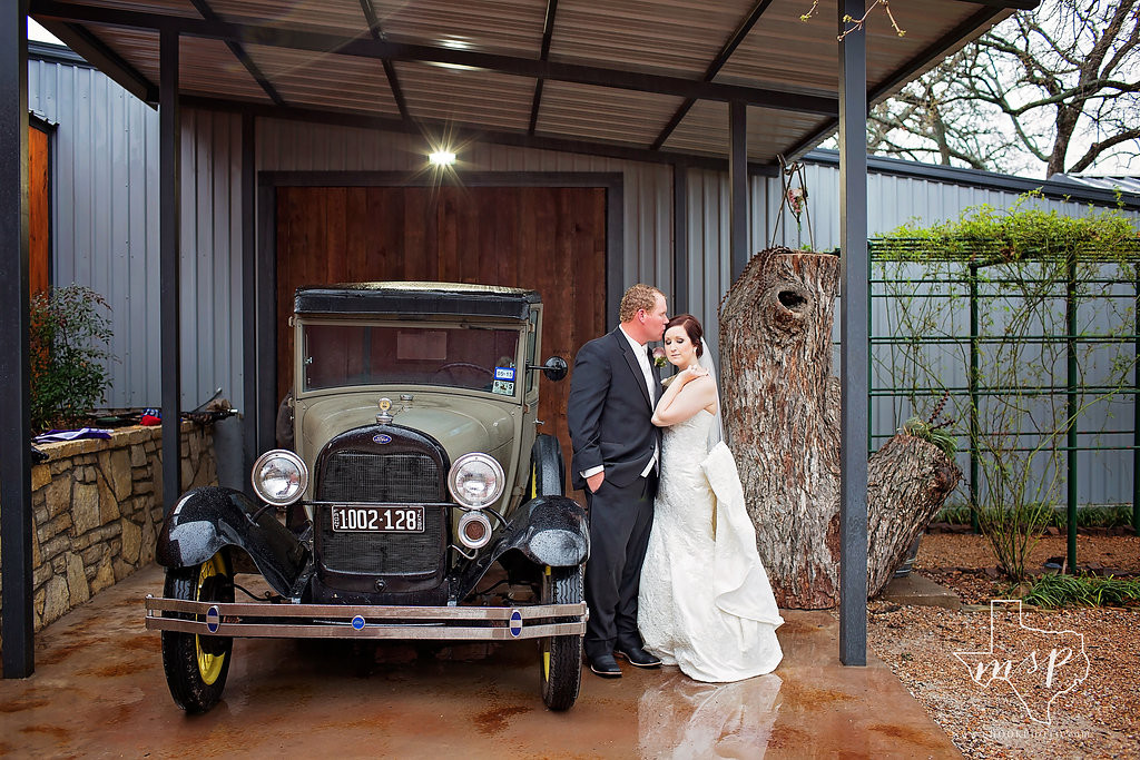 Cool antique get-away car for the bride and groom