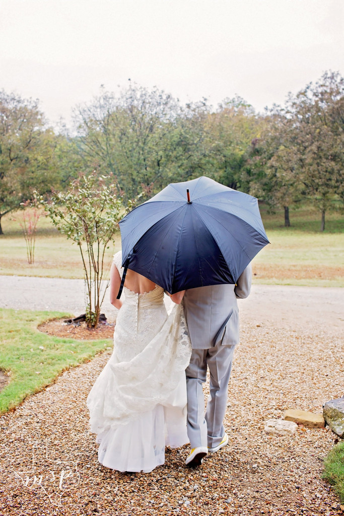 A light afternoon shower doesn't stop this pair of newlyweds from taking advantage of Hollow Hill's gardens