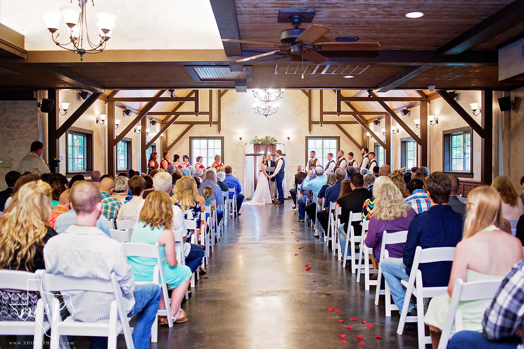 Elegant country indoor wedding ceremony at the venue of Hollow Hill