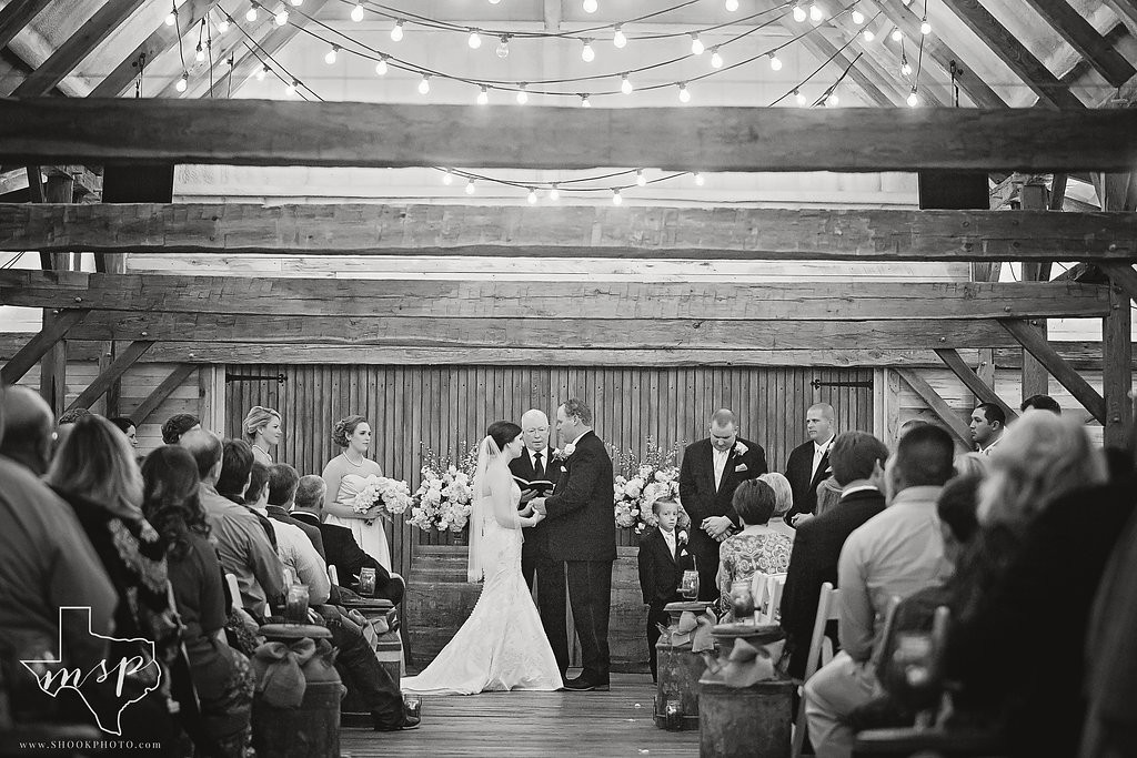 Elegant indoor ceremony in the Hollow Hill's rustic barn