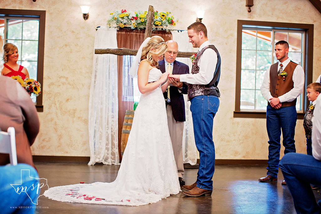 Exchanging rings at this intimate indoor ceremony