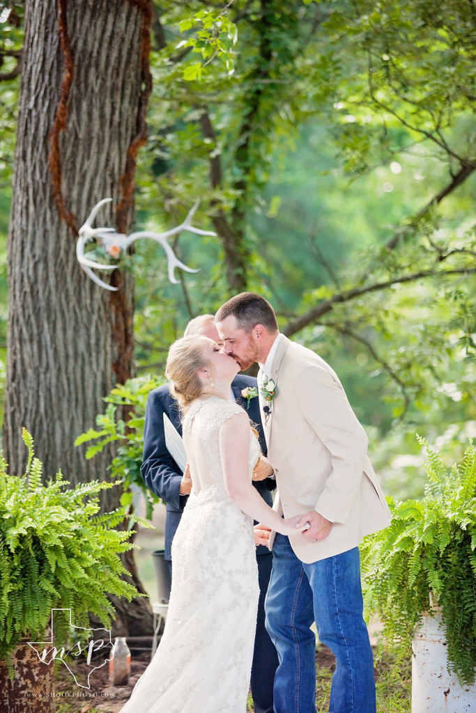Outdoor ceremony under the scenic pecan groves at Hollow Hill in Weatherford