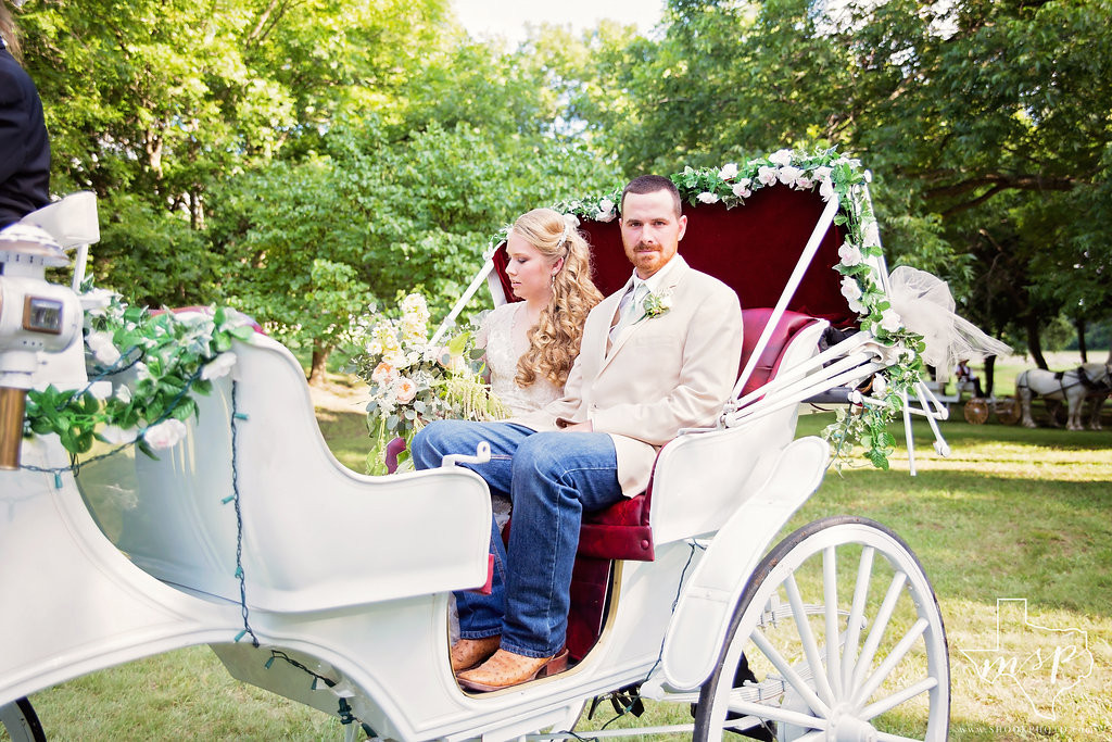 This newly married couple are enjoying a horse-drawn carriage ride through the rolling hills of Weatherford, TX
