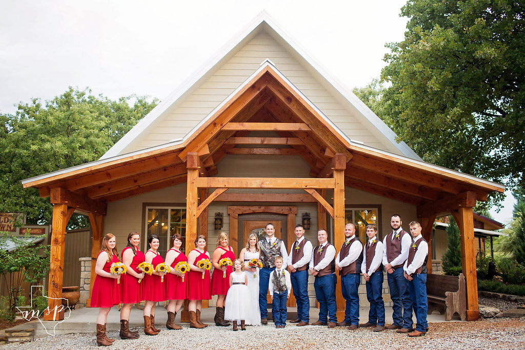 Wedding party in front of the Great Room entrance at Hollow Hill Event Center