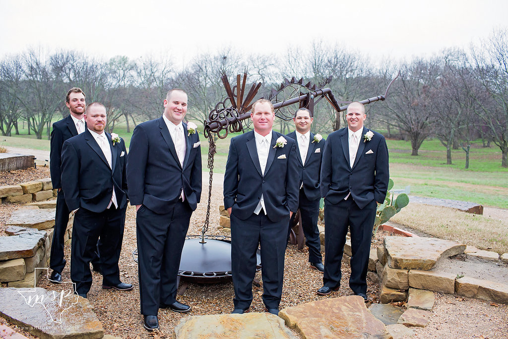 The groom's party at the fire pit in Weatherford
