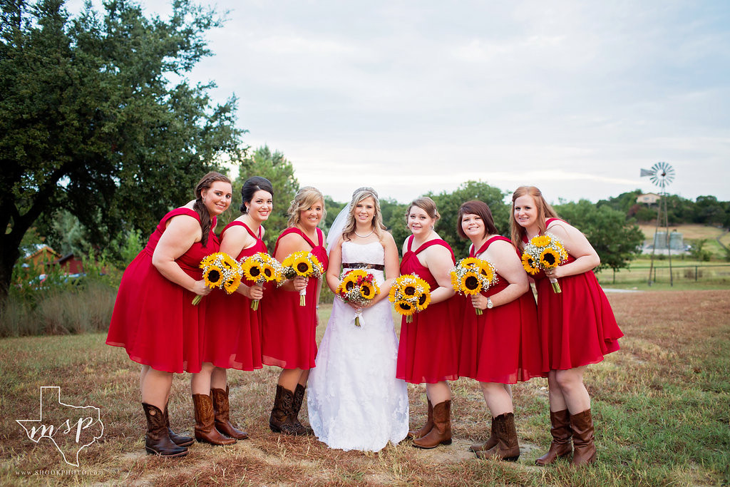 Bridal party in red with sunflowers