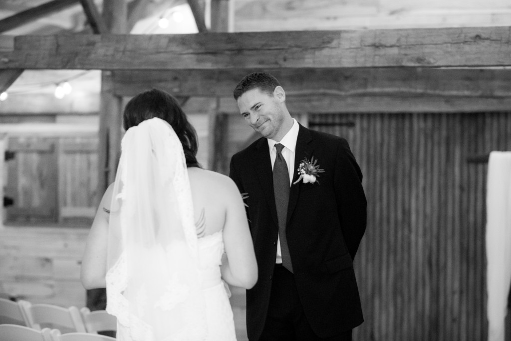 Bride and groom in Hollow Hill's rustic barn preparing for their big day