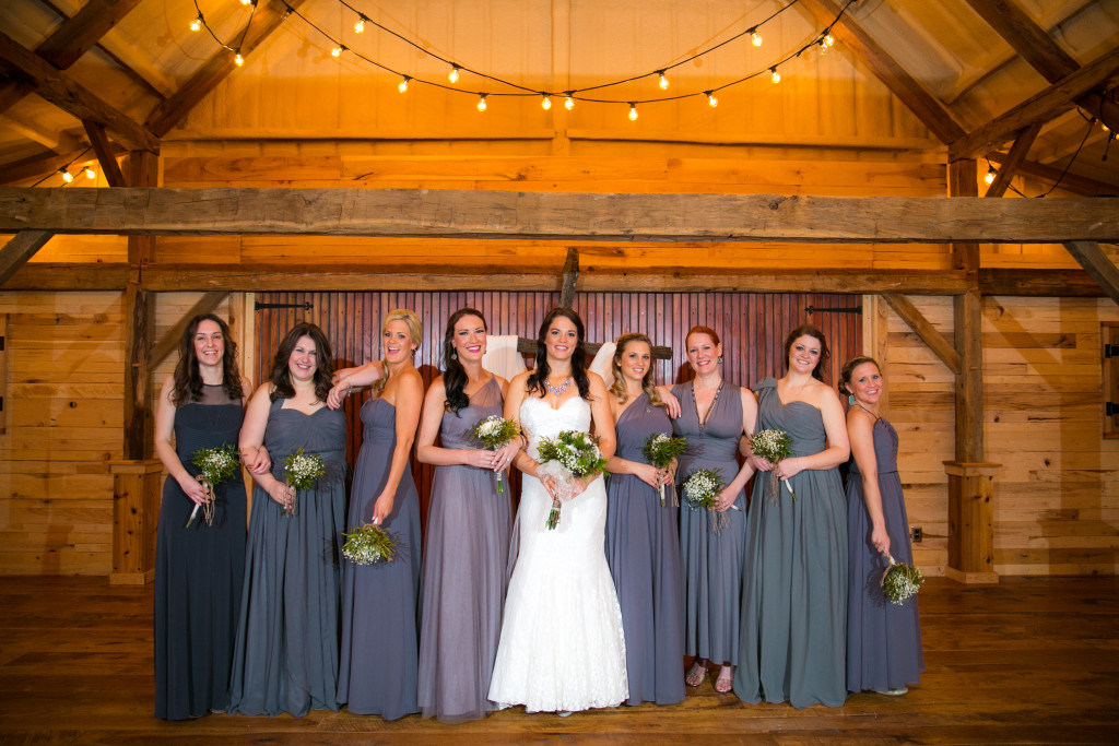 The bridal party having fun in the barn at wedding venue in Weatherford, TX