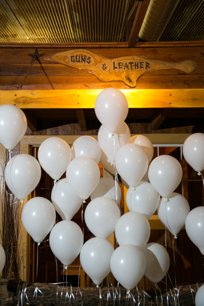 Wedding balloons decorate the hitching post at Hollow Hill