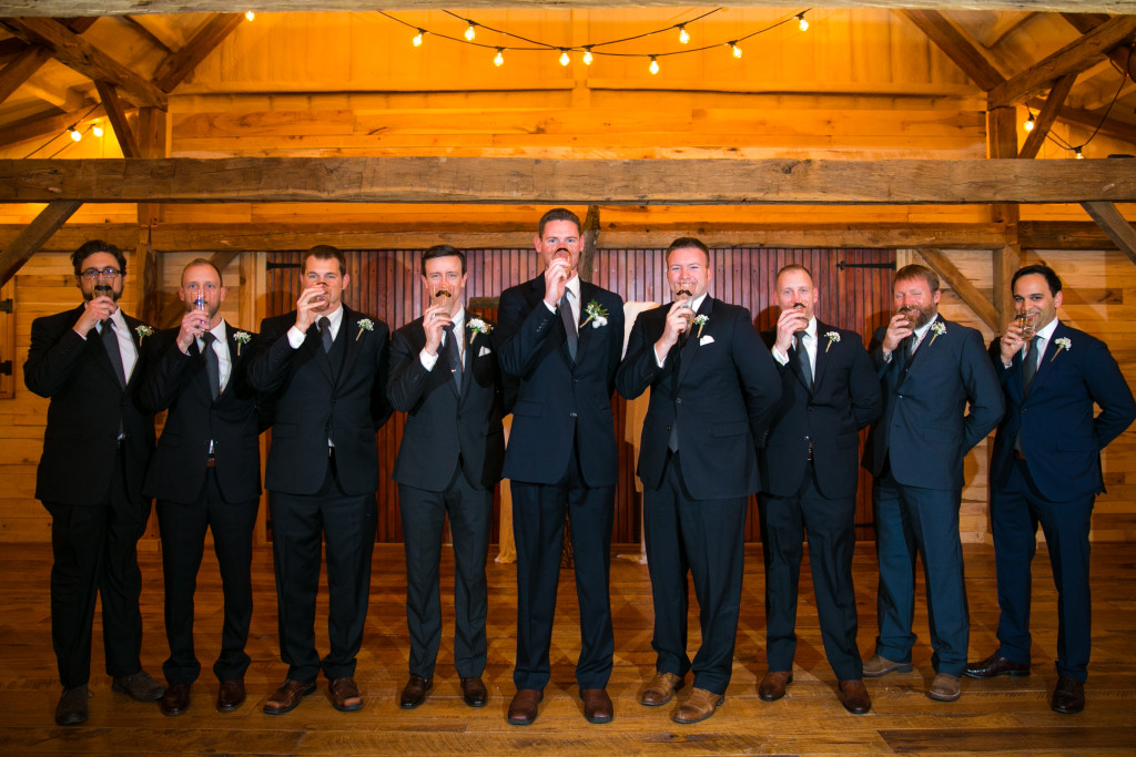 The groom's party having a little fun before the big moment in the rustic barn at Hollow Hill