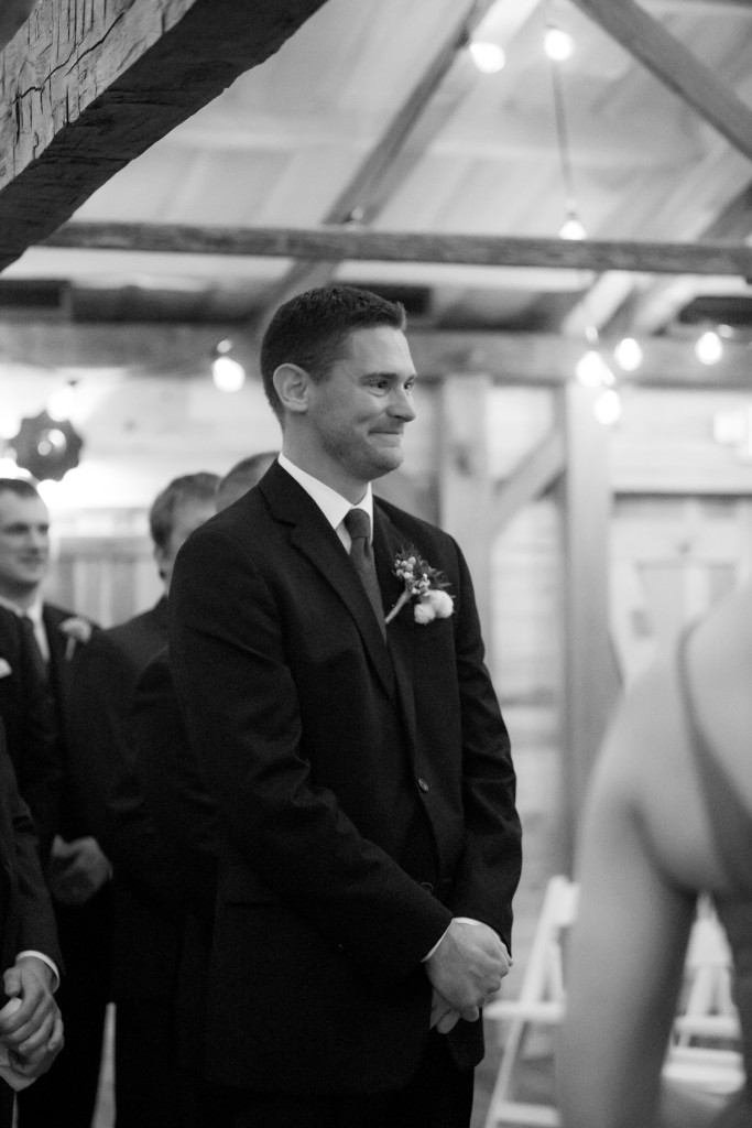 The groom seeing his bride walk down the aisle