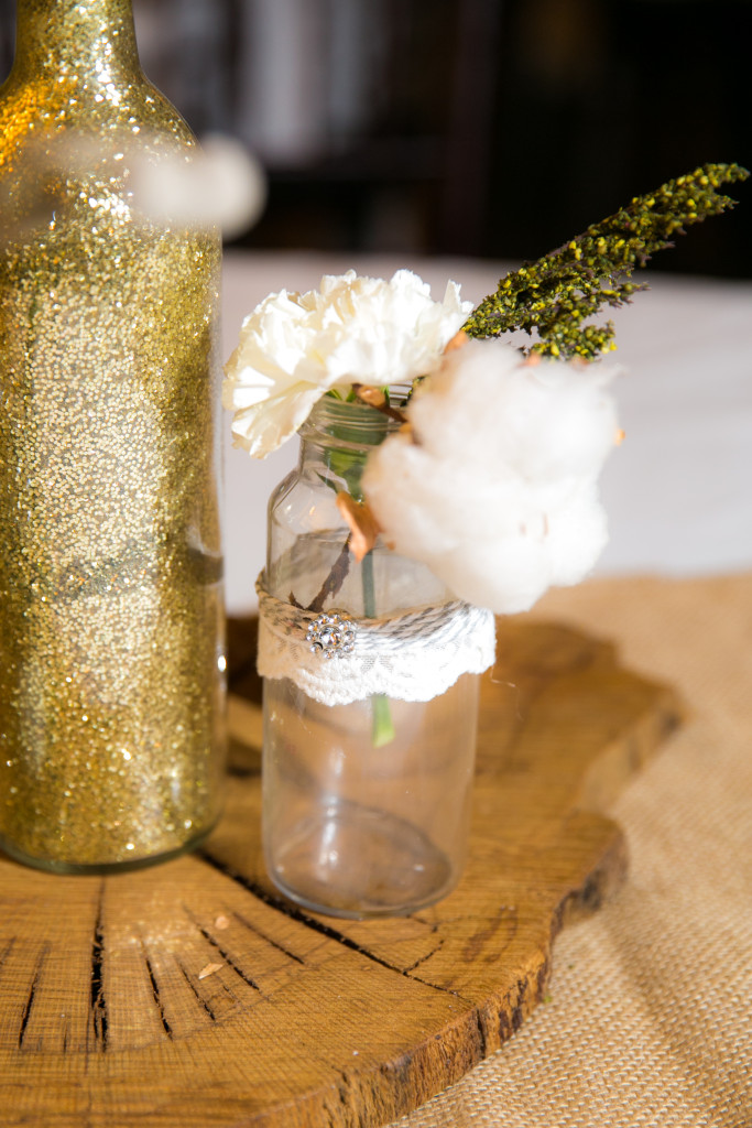 Gold glitter adds sparkle to a wedding reception table centerpiece