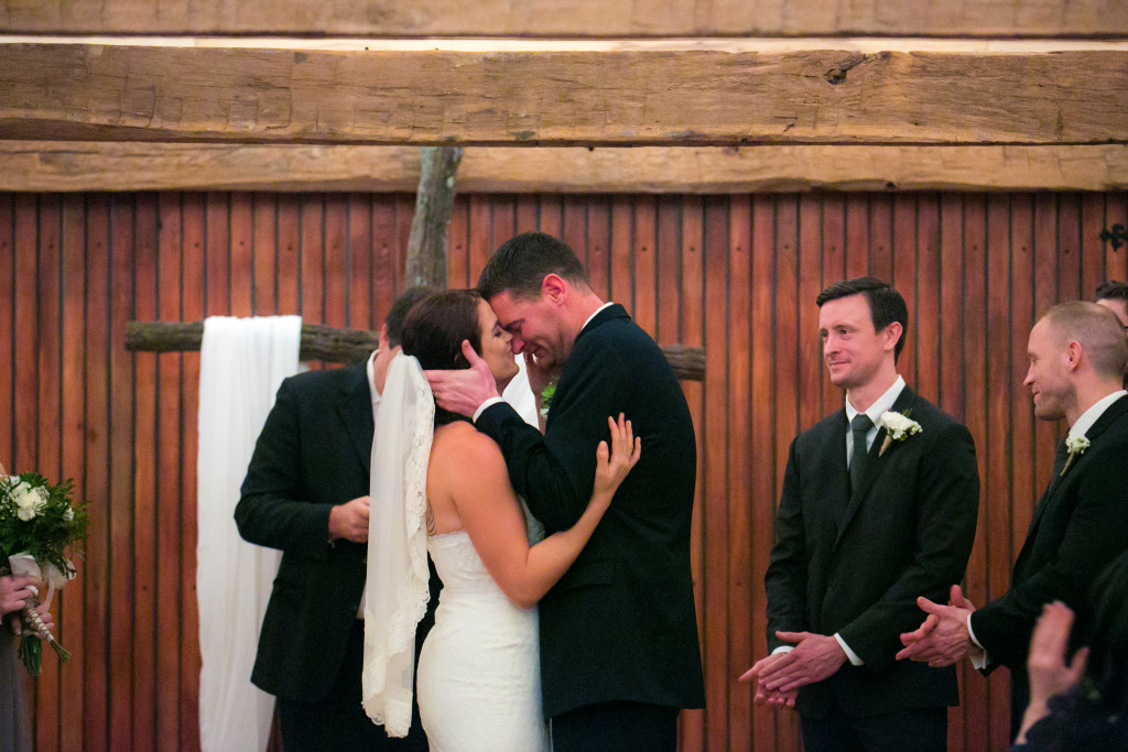 Exchanging vows in a rustic barn
