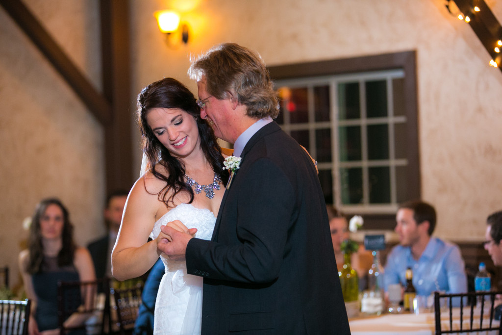 Bride and father of the bride dancing at indoor wedding reception venue