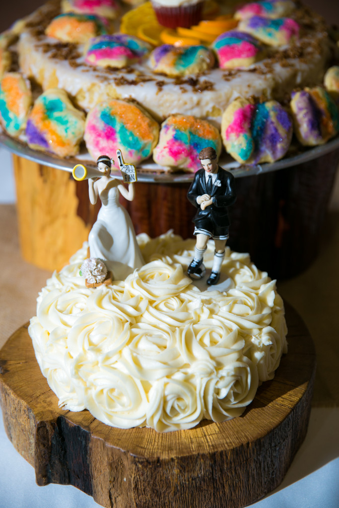 His and her wedding cakes adorned with uniques touches symbolizing the bride and groom